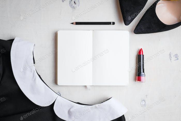 Blank notepad with feminine objects