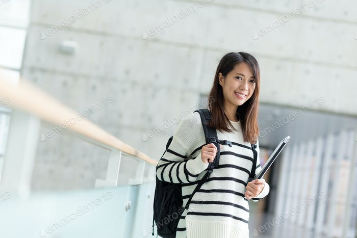 Asian young woman with laptop computer in campus