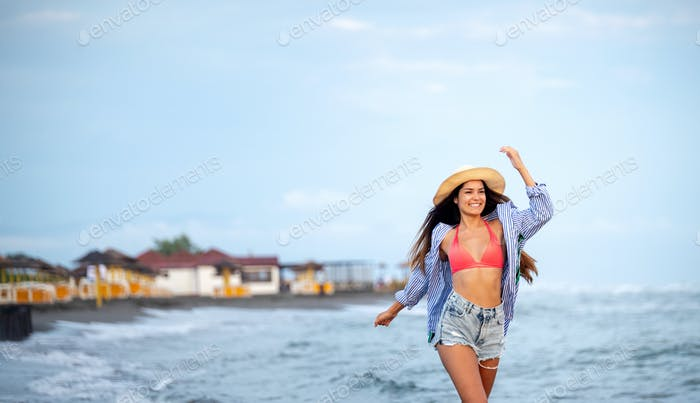 Beautiful girl on the beach at sunset. Summer, travel, vacation concept