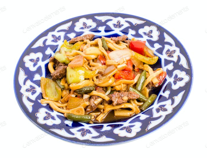 Baked lamb with noodles and stewed vegetables.