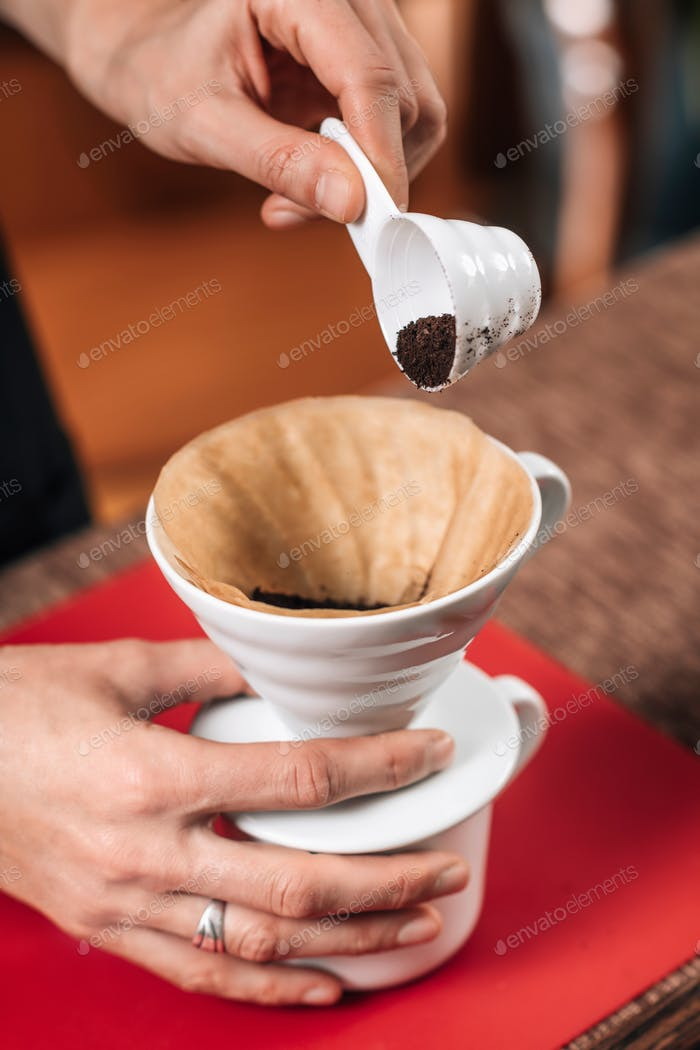 Filter Coffee. Pouring Ground Coffee into Manual Drip Coffee Mak
