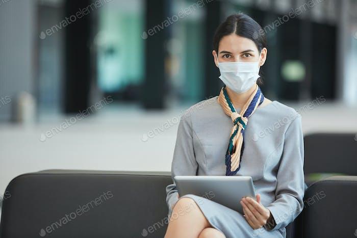 Businesswoman Wearing Mask in Waiting Lounge