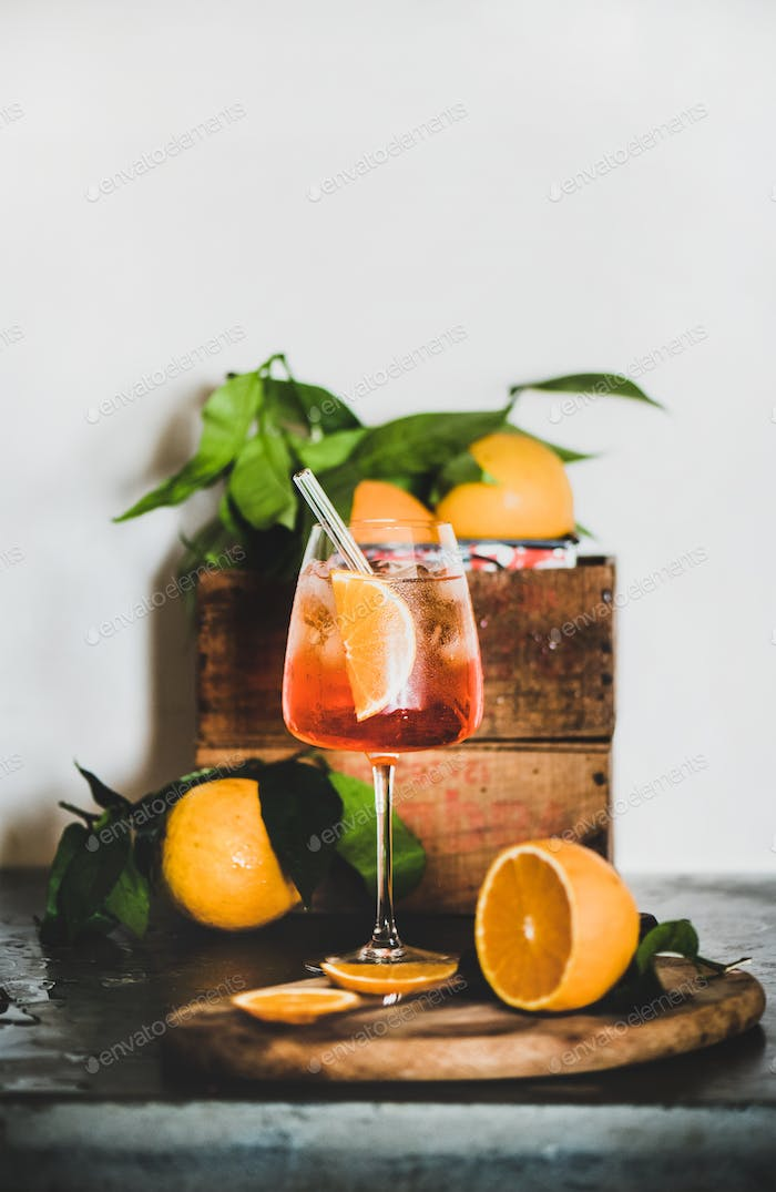 Aperol Spritz cocktail in glass with eco-friendly straw, copy space