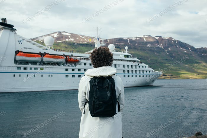 Photographer make photos of cruise ship in fjord