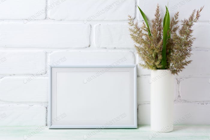 White landscape frame mockup with  grass and green leaves in cyl