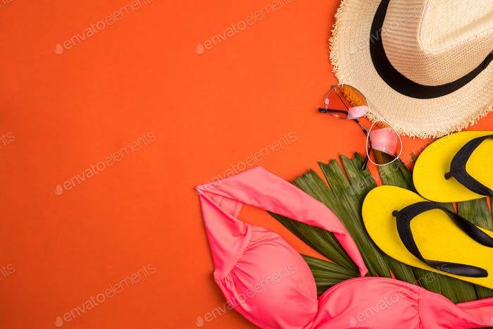 Accerssories for summertime on an orange background.