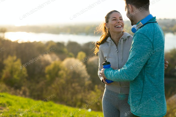 Portrait of man and woman during break of jogging