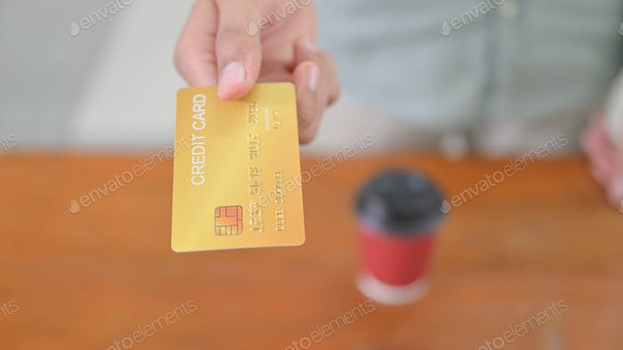 Close-up shot of Paying by credit card.
