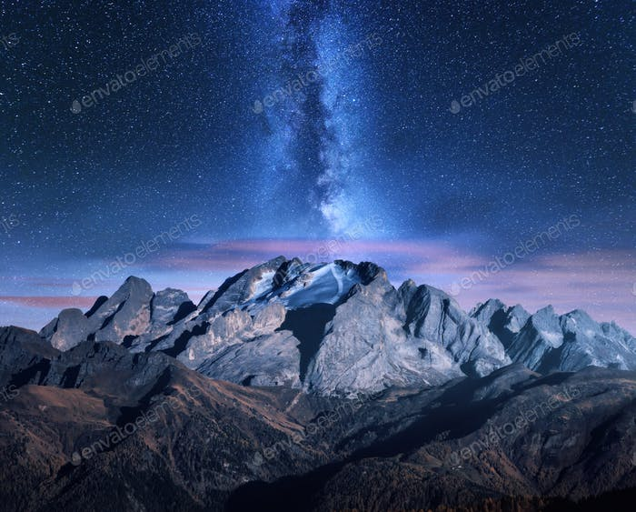 Milky Way and mountains at starry night in autumn