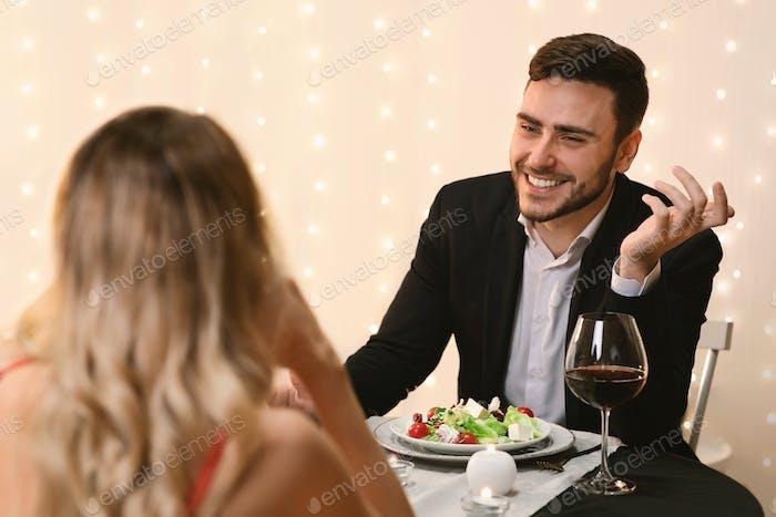 Couple In Love Enjoying Romantic Dinner In Restaurant