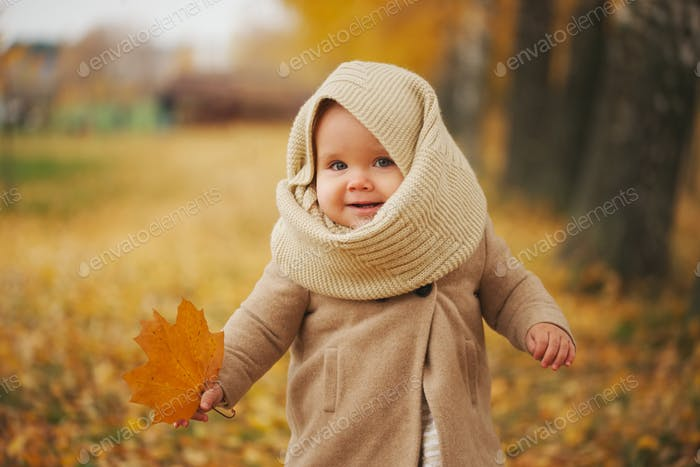 cute happy girl in autumn park
