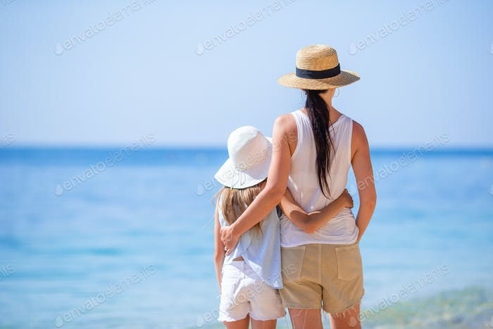 Familly on tropical beach. Mom and kid enjoy their vacation