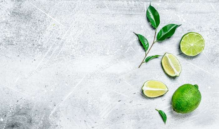 Pieces of fresh juicy lime with foliage.