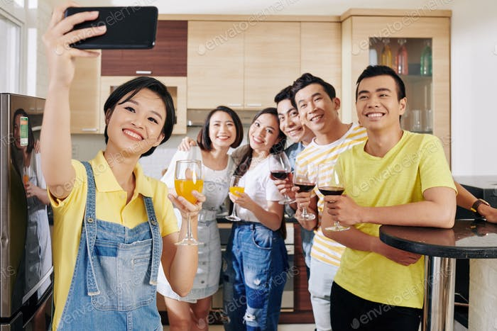 Taking selfie at house party