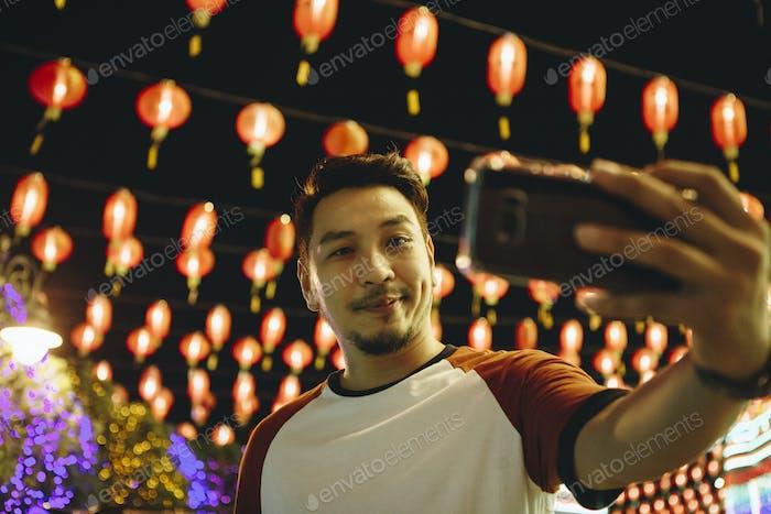 Man taking selfie at lantern festval