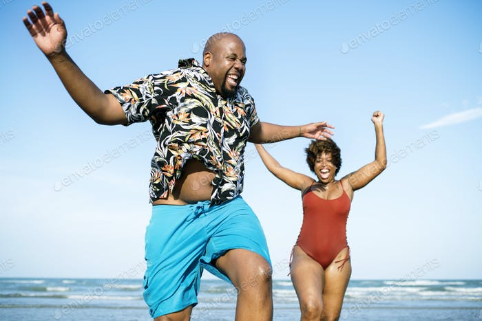 Happy couple playing in the sea