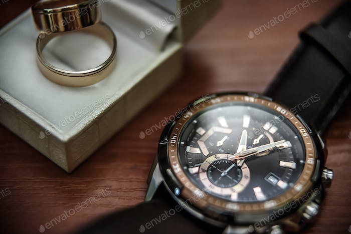 wedding ring in a box and watch the groom