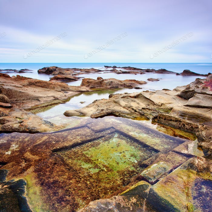 Le Vaschette water pool and rocks seascape near Livorno. Italy.