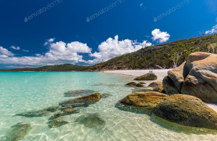 Rocks on Whitehaven Beach with white sand in the Whitsunday Isla