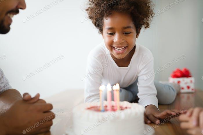 Happy family celebrating birthday of their child