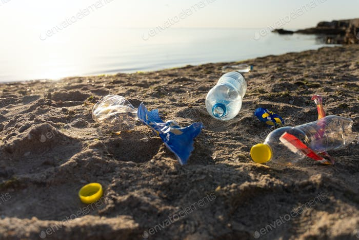 Polluted Beach With Plastic Trash And Single-Use Bottles Near Sea