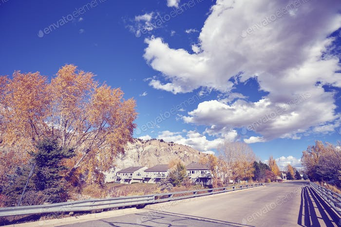 Vintage toned little town road in autumn, Colorado, USA