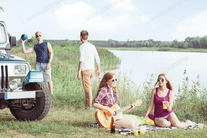 Girl playing guitar during picnic