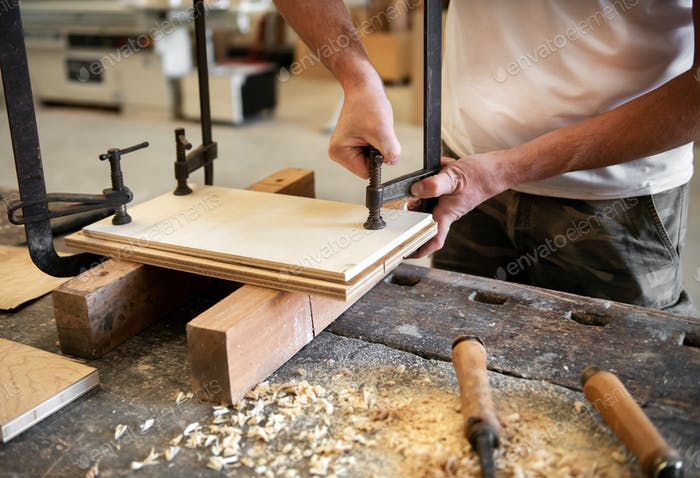 Carpenter or woodworker using a vice