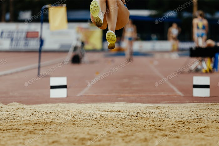 long jump woman legs athlete