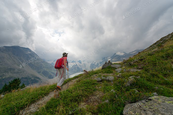 Retired woman practices a hike