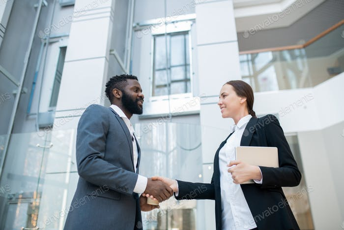 Greeting business colleague in company