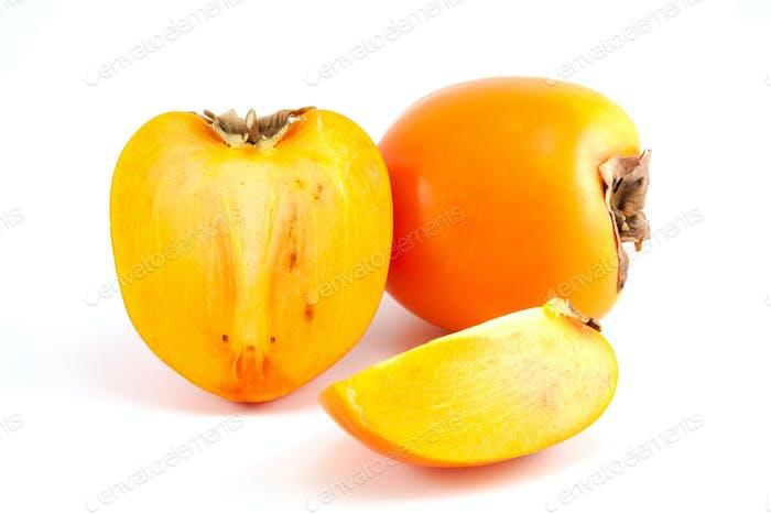 Orange Persimmon mit in Scheiben geschnittenem