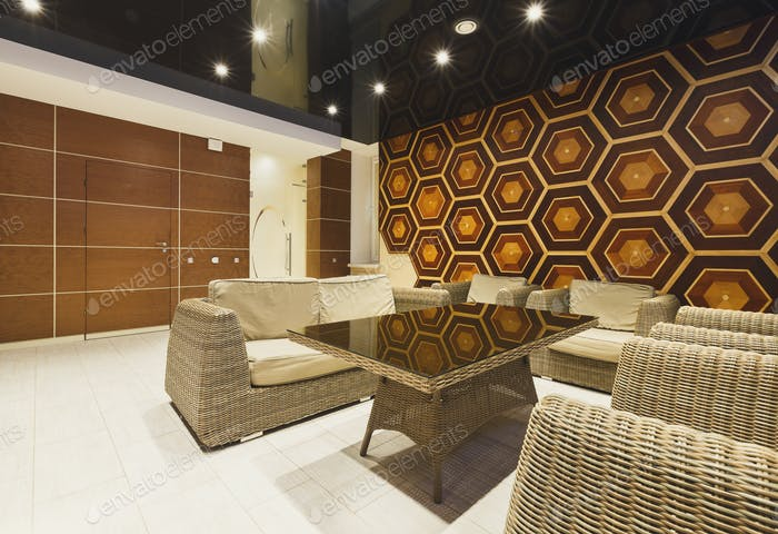 Modern hotel lobby with wicker furniture