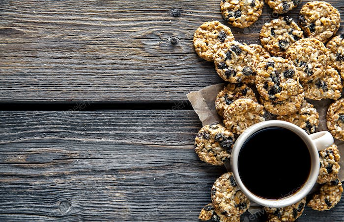 cookies with chocolate and coffee on a wooden background. drink, sweets, breakfast