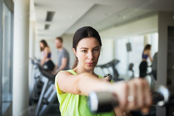 Portrait of attractive fit woman in gym
