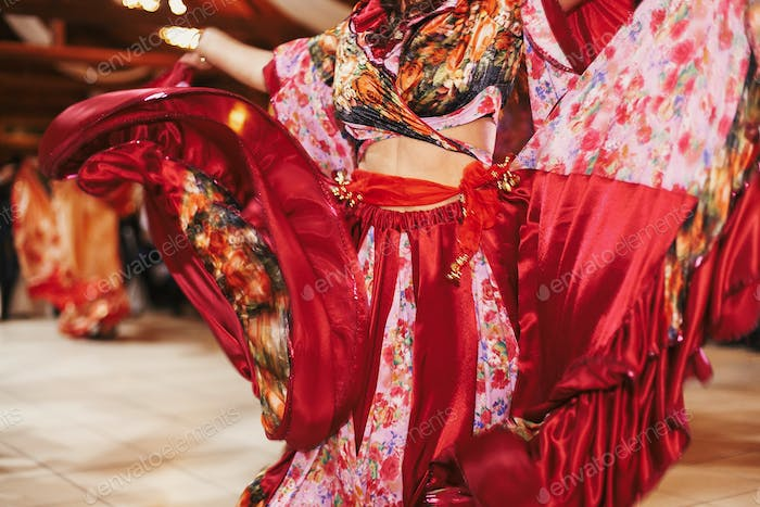Beautiful gypsy girls dancing in traditional floral dress