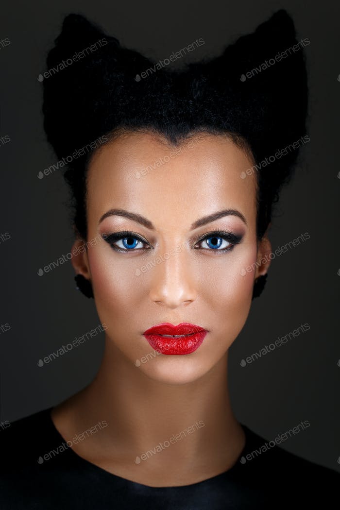 girl with bright makeup and horns hairstyle