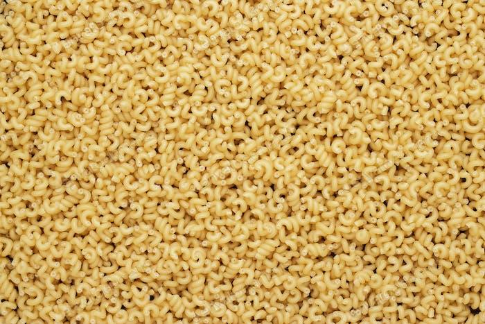 Dry Uncooked Cavatappi Pasta Texture Background