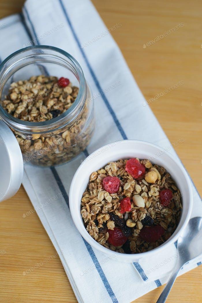 granola with fried oatmeal flakes, hazelnuts, peanuts, dried raisins and cherries