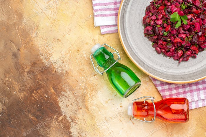 top view Appetizing salad aesthetic oil bottles and free space for words