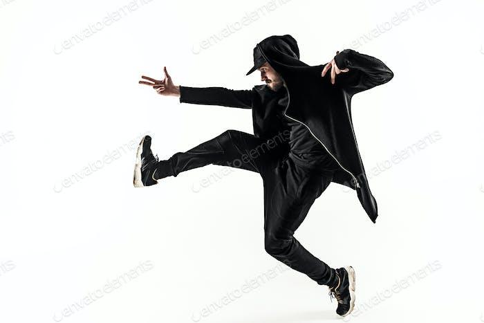 Die Silhouette eines Hip-Hop männlichen Break-Tänzerin tanzen auf weißem Hintergrund