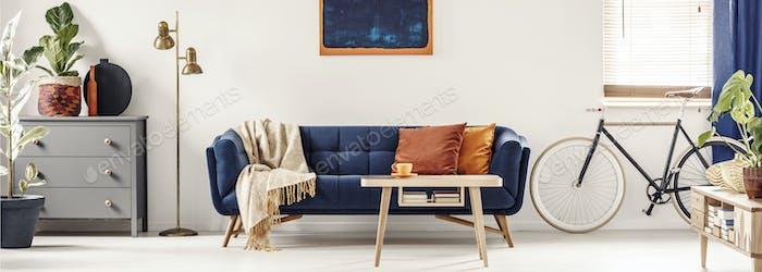 Panorama of a spacious, white living room interior with a retro