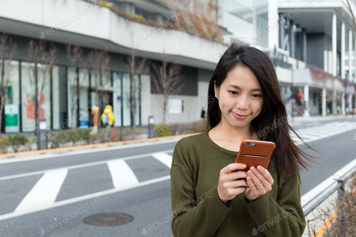 Woman text message on mobile phone