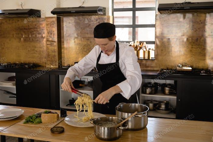 Caucasian chef preparing pasta