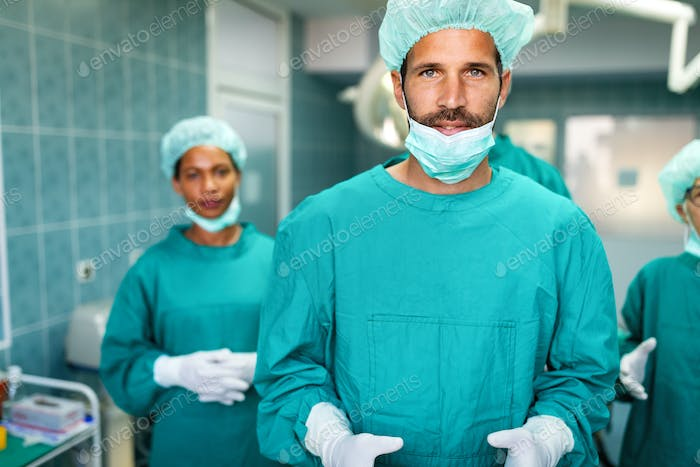 Team of surgeons in the operating room preparing for surgery