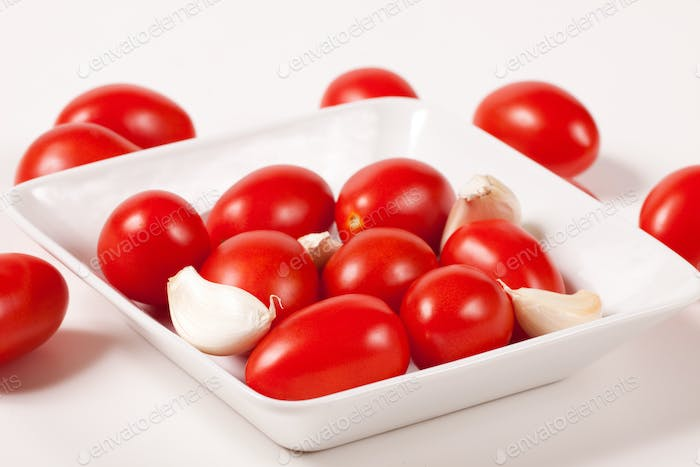 Red Tomatoes with garlik on a plate