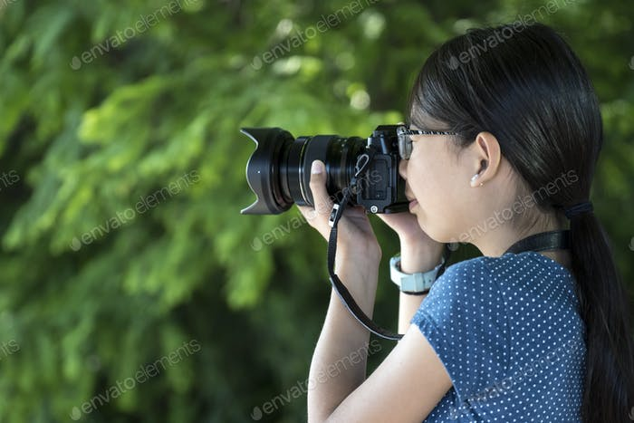 Girl photographer with digital camera