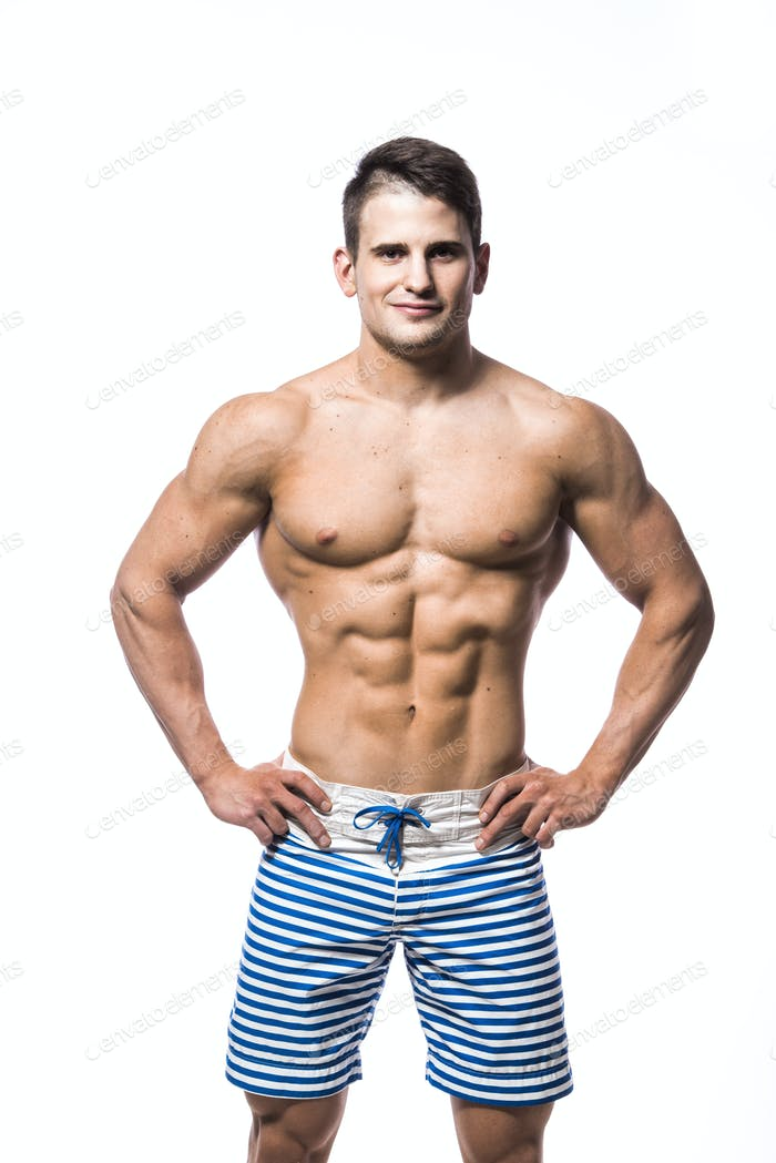 Sexy athletic man showing muscular body and sixpack abs, isolated over white background. Strong male