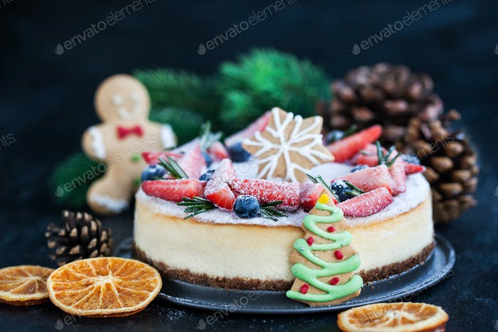 Delicious Christmas ginger cheesecake with fresh berries decorat