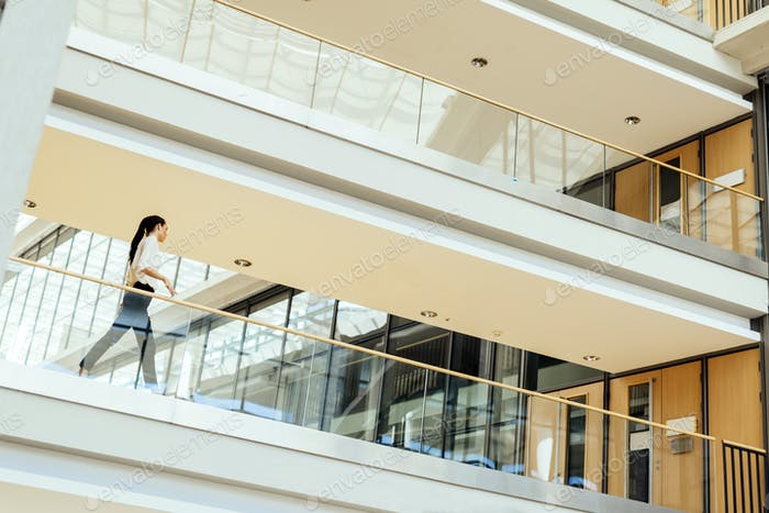 Elegant businesswoman walking inside building